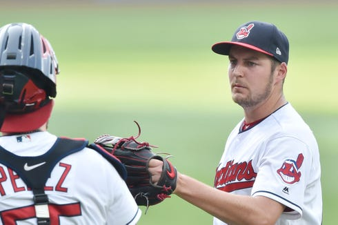 Cleveland Indians starting pitcher Trevor Bauer (right) reacts with catcher Roberto Perez (55) after the first inning against the Chicago White Sox at Progressive Field.
