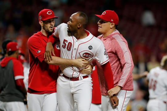 Cincinnati Reds relief pitcher Amir Garrett (50) is pulled away as the Reds and Pittsburgh Pirates brawl in the ninth inning of the MLB National League game between the Cincinnati Reds and the Pittsburgh Pirates at Great American Ball Park in downtown Cincinnati on Tuesday, July 30, 2019. The Pirates won 11-4.