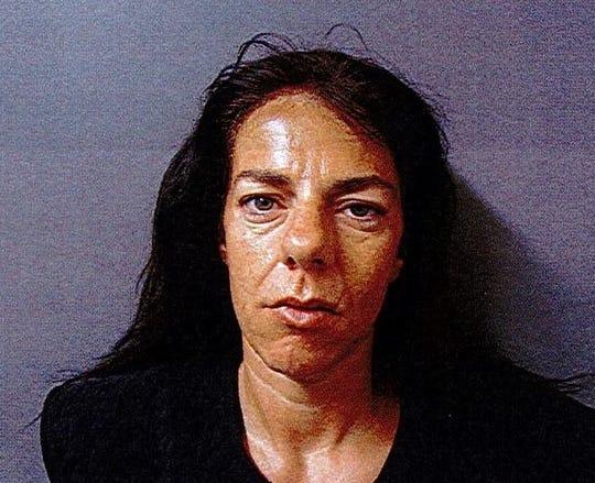 Lawrenceburg woman arrested after man found dead on KY sidewalk