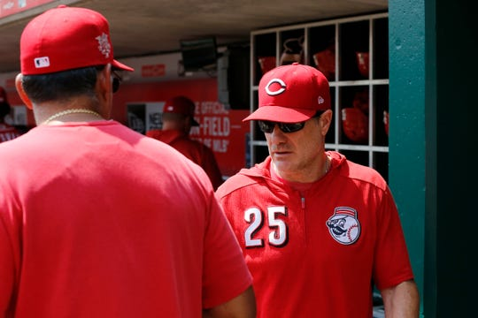 Cincinnati Reds manager David Bell (25) walks through the dugout before the first inning of the MLB National League game between the Cincinnati Reds and the Pittsburgh Pirates at Great American Ball Park in downtown Cincinnati on Wednesday, July 31, 2019. The Reds led 3-0 after three innings.