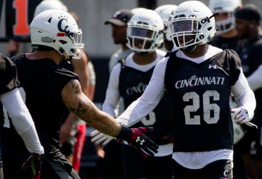 Cincinnati Bearcats safety Kyriq McDonald (26) high fives a teammate during Cincinnati Bearcats football practice Wednesday, July 31, 2019, at the University of Cincinnati.