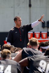 Cincinnati Bearcats head coach Luke Fickell speaks to Cincinnati Bearcats players after practice during Cincinnati Bearcats football practice Wednesday, July 31, 2019, at the University of Cincinnati.
