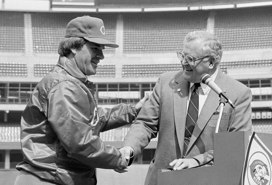 Pete Rose is welcomed at the podium by Cincinnati Reds President Bob Howsam (right) at the start of a press conference at Riverfront Stadium, Thursday afternoon, August 16, 1984 where Rose was named player-manager.