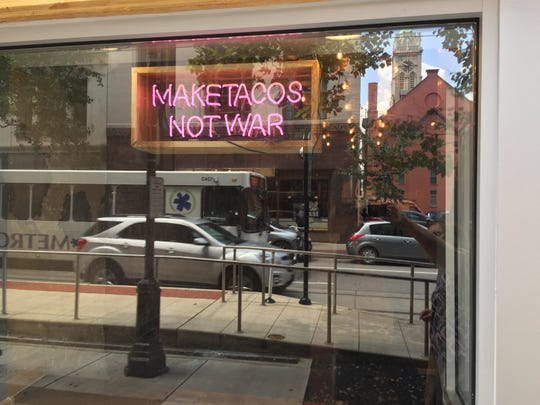 A message in the front window of Centro, Downtown