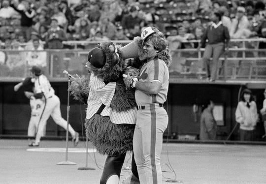 The Phillie  Phanatic was originally portrayed by David Raymond for fifteen years, from 1978 to 1993. The team mascot greeted Montreal Expos' Pete Rose before Monday night's game at Veterans Stadium in Philadelphia on May 1, 1984.