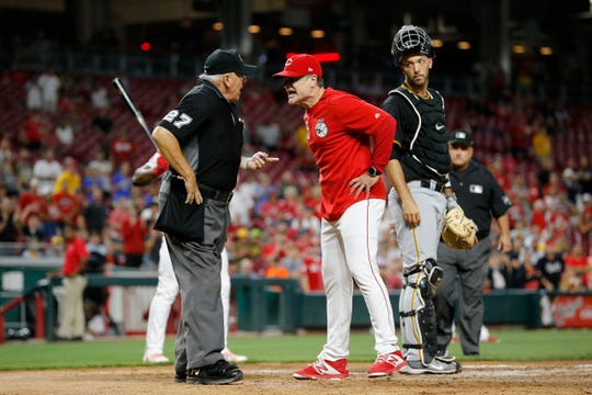 Cincinnati Reds manager David Bell (25) is ejected after arguing strikes with umpire Larry Vanover (27) in the eighth inning of the MLB National League game between the Cincinnati Reds and the Pittsburgh Pirates at Great American Ball Park in downtown Cincinnati on Tuesday, July 30, 2019. The Pirates won 11-4.