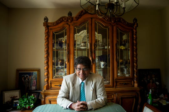 Harold D'Souza, a member of the United States Advisory Council on human trafficking, poses for a portrait in his home in Blue Ash Monday, July 29, 2019.