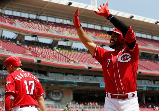 Cincinnati Reds third baseman Eugenio Suarez (7) waves to fans as he celebrates a two-run home run in the third inning of the MLB National League game between the Cincinnati Reds and the Pittsburgh Pirates at Great American Ball Park in downtown Cincinnati on Wednesday, July 31, 2019. The Reds led 3-0 after three innings.