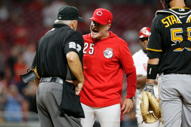 Cincinnati Reds manager David Bell (25) argues with umpire Larry Vanover (27) over strikes in the eighth inning of the MLB National League game between the Cincinnati Reds and the Pittsburgh Pirates at Great American Ball Park in downtown Cincinnati on Tuesday, July 30, 2019. The Pirates won 11-4.