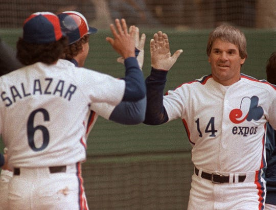 Montreal Expos Pete Rose in congratulated by teammates Gary Carter and Argenis Salazar following his 4000th career hit during the Expo's home opener on April 13, 1984 against the Philadelphia Phillies.