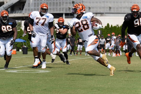 Bengals running back Joe Mixon (28) runs the ball at the Cincinnati Bengals training camp on Wednesday July 31, 2019 at Paul Brown Stadium.