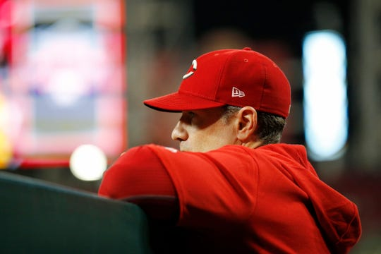 Cincinnati Reds manager David Bell (25) watches from the dugout in the eighth inning of the MLB National League game between the Cincinnati Reds and the Pittsburgh Pirates at Great American Ball Park in downtown Cincinnati on Tuesday, July 30, 2019. The Pirates won 11-4.