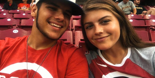 Keegan Nickoson of Ross and Carissa Osborne take in a Reds game in section 104 Tuesday, July 30, against the Pittsburgh Pirates.