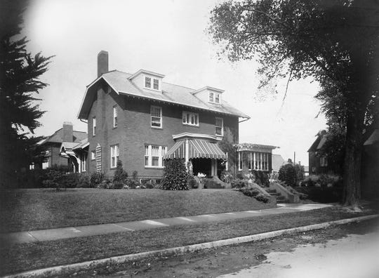 A historic photo of the residence at 406 Chestnut St. built in 1923 by Dr. James G. Smailes Sr. The house and its contents will be auctioned off on Thursday.