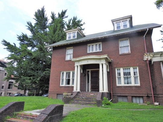 The historic home at 406 Chestnut St. is up for auction on Thursday. On the land is a ginkgo tree believed to have been planted in 1855, coming from Japan following a visit by Matthew C. Perry.