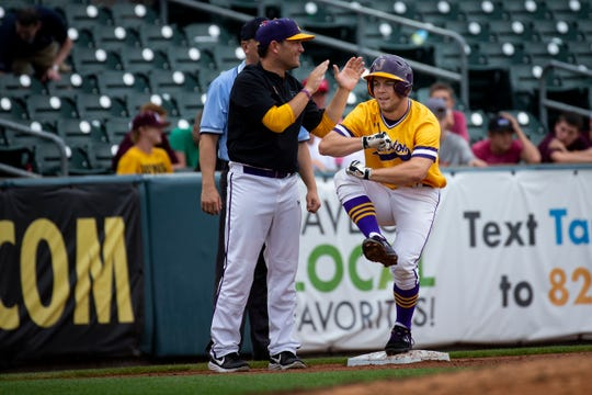 Johnston's Andrew Nord (6) celebrates his triple while standing on third during their 4A state baseball quarterfinal game at Principal Park on Wednesday, July 31, 2019 in Des Moines. Johnston would go on to defeat Ankeny 6-0.