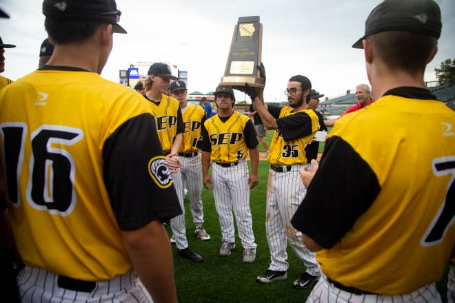 Southeast Polk raises their state participant trophy during their 4A state baseball quarterfinal game loss to Dowling Catholic 7-0 at Principal Park on Wednesday, July 31, 2019 in Des Moines.