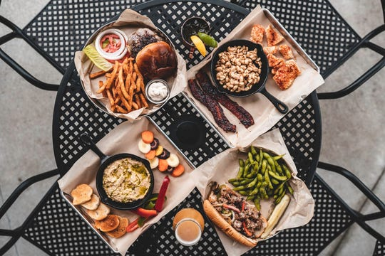 The HandleBar in Dallas Center has opened serving craft beer and homemade American food where guests can roam around on on two acres.