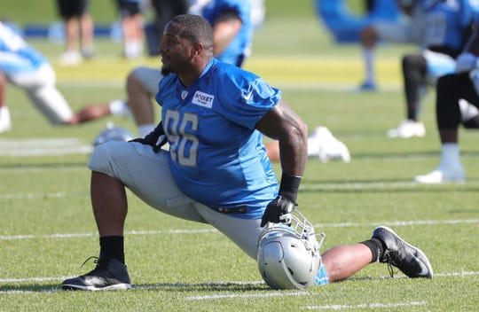 Lions defensive tackle Mike Daniels stretches during practice during training camp on Tuesday, July 30, 2019, in Allen Park.
