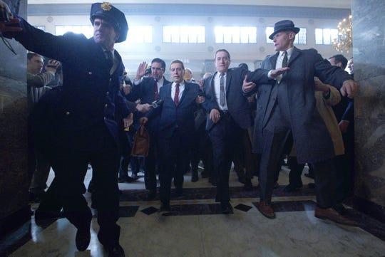 """Ray Ramano (Bill Bufalino), Al Pacino (Jimmy Hoffa) and Robert De Niro (Frank Sheeran) in """"The Irishman."""""""
