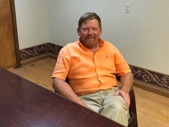 The Rev. Dennis H. Kucharczyk is pictured July 24, 2019, inside the downtown Bay City law office of attorney Matthew L. Reyes. Kucharczyk,  who is on administrative leave while church officials investigate an allegation of misconduct with a minor, says he is innocent.
