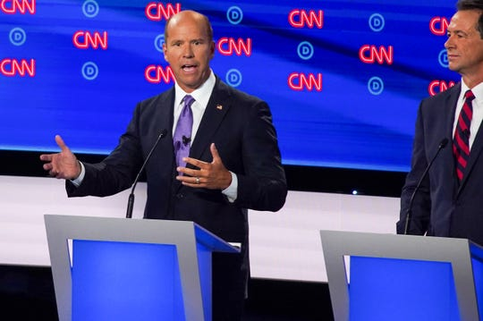 Democratic presidential candidate former U.S. Rep. John Delaney, left, speaks during the first night of the Democratic presidential debates at the Fox Theatre in Detroit on Tuesday, July 30, 2019.
