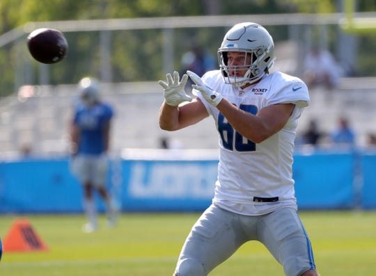 Detroit Lions tight end T.J. Hockenson catches passes during training camp Saturday, July 27, 2019 in Allen Park, Mich.