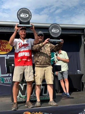 First-place pro-angler David Kolb (left) and co-angler Robert Olson (right) display their trophies at the National Walleye Tour Presented by Cabela's and Bass Pro Shops event at Sault Ste. Marie, Michigan, on July 26.