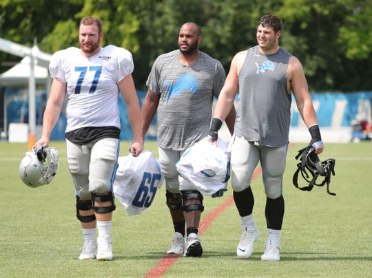(From left) Lions offensive lineman  Frank Ragnow, Tyrell Crosby and Joe Dahl walk off the field at training camp on Wednesday, July 31, 2019, in Allen Park.