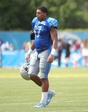Lions linebacker Anthony Pittman walks off the field after during training camp on Wednesday, July 31, 2019, in Allen Park.
