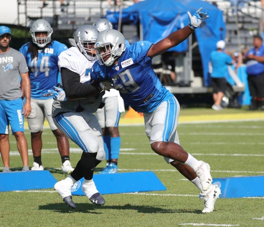 Lions running back C.J. Anderson blocks linebacker Tre Lamar during practice during training camp on Tuesday, July 30, 2019, in Allen Park.