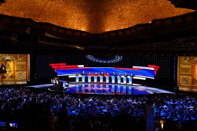 Candidates speak on stage on the first night of the Democratic presidential debates at the Fox Theatre in Detroit on Tuesday, July 30, 2019.