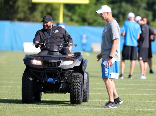 Lions coach Matt Patricia and offensive coordinator Darrell Bevell talk during practice during training camp on Tuesday, July 30, 2019, in Allen Park.