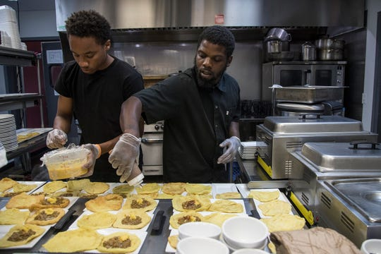 Kitchen chef Jaquan Mays and Angelo Knight prepare the second course during the Detroit Free Press/ Metro Detroit Chevy Dealers Top 10 Takeover of Norma G's in Detroit, Tuesday, July 30, 2019.