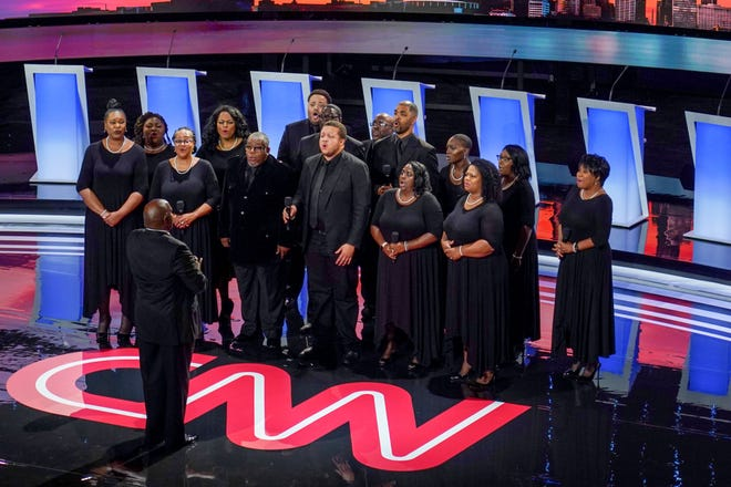 A choir performs during the first night of the democratic presidential debates at the Fox Theatre in Detroit on Tuesday, July 30, 2019.