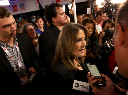 Democratic Marianne Williamson talks with the media in the spin room after the Democratic Presidential debate at the Fox Theatre in Detroit, Michigan on Tuesday, July 30, 2019.