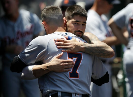 Nicholas Castellanos, top, hugs and says farewell to Jordy Mercer in the dugout, after Castellanos was traded to the Cubs, on Wednesday.