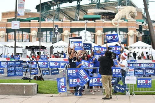 In a largely empty area across Woodward Avenue from the Fox Theatre, a group of Biden supporters cheer for a television camera before the second round of the Democratic Presidential Debates in Detroit , Wednesday.