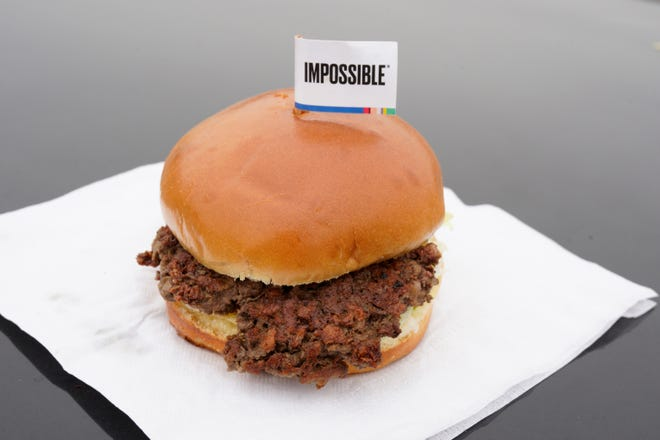 After months of shortages, Impossible Foods is partnering with a veteran food production company to ramp up supplies of its popular plant-based burgers.