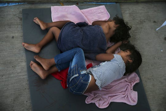 In this July 17, 2019 file photo, migrant children sleep on a mattress on the floor of the AMAR migrant shelter in Nuevo Laredo, Mexico. The American Civil Liberties Union said Tuesday, July 30, 2019 that more than 900 children have been separated from their families at the border since a judge ordered last year that the practice be sharply curtailed. The ACLU says about one of every five children separated is under 5 years old.