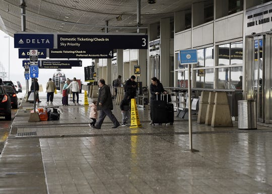 The security checkpoint at the North Terminal at Detroit Metro Airport in Romulus was temporarily closed Sunday after a man bypassed security with his child without being screened.