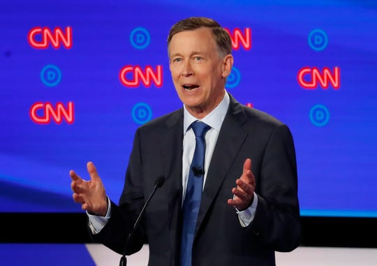 Former Colorado Gov. John Hickenlooper speaks Tuesday night during the first of two Democratic presidential primary debates in Detroit.