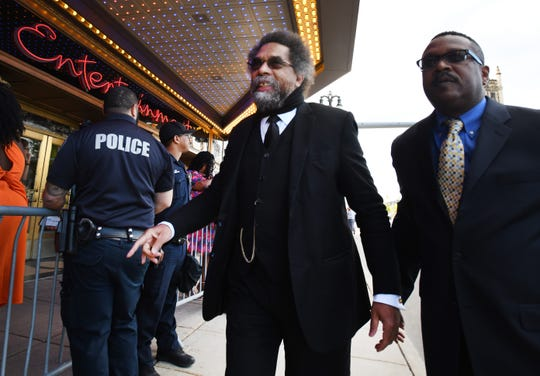 Philosopher and activist Dr. Cornel West arrives at the Fox Theatre for night two of the Democratic presidential primary debates.