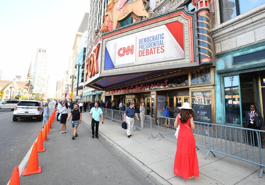 People arrive at the Fox Theatre in Detroit for night two of the Democratic presidential debates on Wednesday, July 31, 2019.