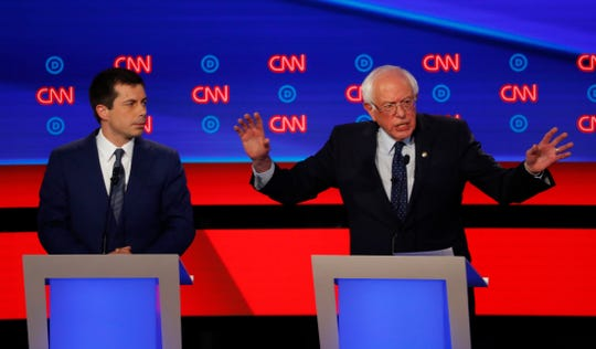 Sen. Bernie Sanders, I-Vt., speaks as South Bend Mayor Pete Buttigieg listens during the first of two Democratic presidential primary debates hosted by CNN July 30, 2019 at Fox Theatre in Detroit.