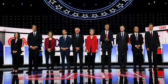 Ten candidates take the stage for the Democratic presidential debates at the Fox Theatre in Detroit on Tuesday, July 30, 2019.  From left, Marianne Williamson, Rep. Tim Ryan, D-Ohio, Sen. Amy Klobuchar, D-Minn., South Bend Mayor Pete Buttigieg, Sen. Bernie Sanders, I-Vt., Sen. Elizabeth Warren, D-Mass., former Texas Rep. Beto O'Rourke, former Colorado Gov. John Hickenlooper, former Maryland Rep. John Delaney and Montana Gov. Steve Bullock.