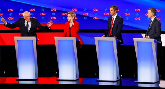 Sen. Bernie Sanders, I-Vt., Sen. Elizabeth Warren, D-Mass., former Texas Rep. Beto O'Rourke and former Colorado Gov. John Hickenlooper participate in the first of two Democratic presidential primary debates hosted by CNN Tuesday, July 30, 2019, in the Fox Theatre in Detroit.