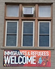 The words 'Immigrants & Refugees Welcome' on a banner on the north wall of the Central United Methodist Church in Detroit in July encouraged presidential candidates to 'embrace bold pro-immigration policies.