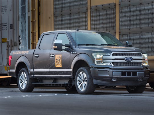 Ford Motor Co. and three foreign carmakers struck a deal with Californiathat defies the Trump administration's plan to cut fuel-economy targets. Ford has been testing an all-electric F-150 prototype.