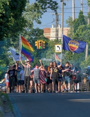 Flint City Bucks' supporters group, the River Rats, marches to Kettering University's Atwood Stadium ahead of the USL League 2 team's match